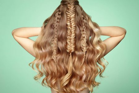 blonde-girl-with-long-and-shiny-curly-hair-8SN3KC6