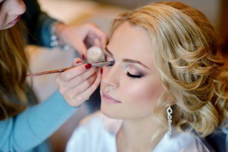 wedding-makeup-artist-making-a-make-up-for-bride-PS3LQDV